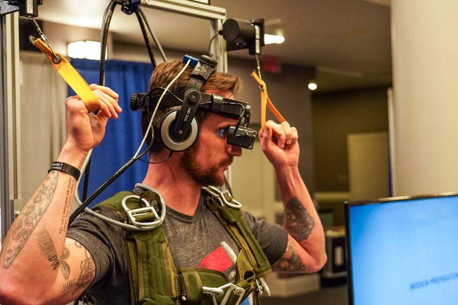 man testing simulation equipment at PIA Symposium