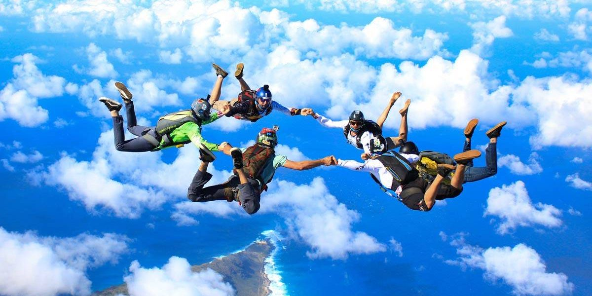 Group of experienced skydivers in formation during free fall.